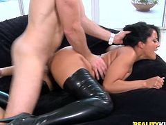 Sexy dark-haired mom Kiara Mia wearing latex clothes and high heels is having fun with some horny man. She lets him lick her snatch and then they bang doggy style and in cowgirl position.
