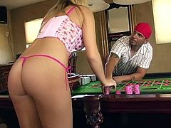 Get a hard dick watching this blonde girl, with giant gazongas wearing a pink thong, while she strips and masturbates over a roulette table.