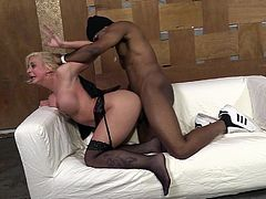 Take a look at this hardcore scene where the busty blonde Leya Falcon has her asshole drilled by a guy's black monster cock.