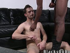 He is a damn faggot and today he is going to enjoy a huge black cock in his mouth first. Then, it moves deep in his asshole and he sighs.