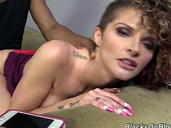 After getting her tight, shaved pussy fucked hard by this hung, black stud, white girl Joslyn lets him fill her up with his jizz.