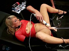 Lewd blonde Casey Cumz is lying in an arm chair with her legs spread wide open. Some dude pleases the bitch with fingering and then drills her cunt with the help of a fucking machine.