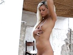 With hairless cunt does striptease before masturbating with desire