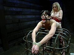 Hot blonde Aiden Starr is having BDSM fun with Bobbi Starr in a basement. Bobbi gets bound and takes a mouthgag and then enjoys being tortured and banged with a strapon.