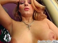 Masturbate watching this redhead MILF, with giant breasts wearing high heels, while she goes hardcore in the living room and gets a cumshot in her mouth!
