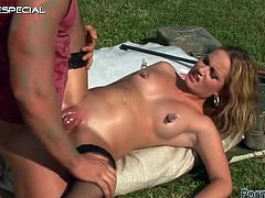 Gabriella is a slutty blonde being fucked silly outdoors after this guy pumps her pussy lips and shoves a dildo up her tight butthole.