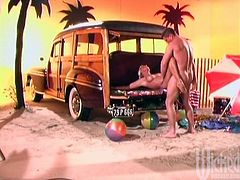 A day of fun in the sun turns hardcore when this sexy girl meets a guy and ends up fucking him in the back of his car at the beach.