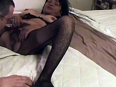 She loves to suck cock so while wearing her sexy fishnets this mature babe gets on her knees and nurses on that hard cock.