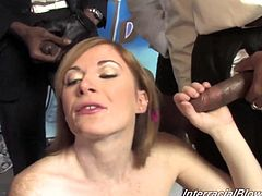 That's a hell of a bukkake going on! Kinky Ashley Blue gets on her knees and starts enjoying a lot of black cocks! She sucks some cum out of them!