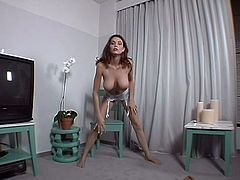 She's beautiful, sensual and horny. The hot brunette knows that we are watching her every move so she takes her time and slowly puts on her bra and removes her nylons. This bitch loves our attention and now maybe she will put those nylons were they belong, to receive more!