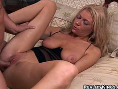 Entertain yourself by watching this blonde cougar, with huge boobs wearing sexy lingerie, while she goes hardcore over a nice bed.