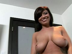 Get wild watching this short haired brunette, with gigantic knockers and a shaved pussy, while she gets fucked hard in a POV video.