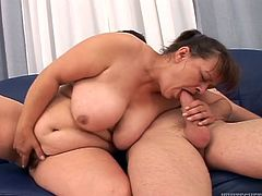 Mature BBW takes her clothes off. She gives a blowjob to younger guy and then gets her hairy pussy fucked hard. It is probably her best sex.
