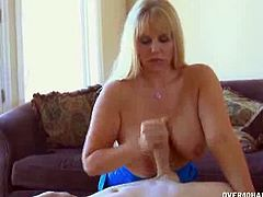 Karen Fisher loves teasing the delivery guys. When Jim arrives he gets rock hard when Mrs. Fisher answers the door. He lets him fuck her monster tits while jerking him.