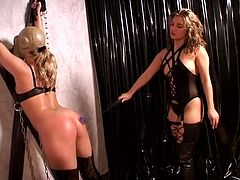 Young blonde with gas mask gets spanked by her obsessed mistress.