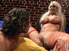 Curvaceous MILF in fishnets fondles her big tits and gets her vagina licked. After she lies down on a couch and gets her shaved pussy destroyed.
