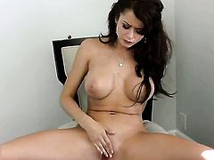Emily Addison strips down to her bare skin and masturbates with dildo