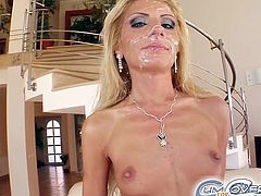 Lewd blonde mom Gia strips and shows her small tits to two dudes. Then she squats in front of them and sucks their boners till they explode with sperm on her face.
