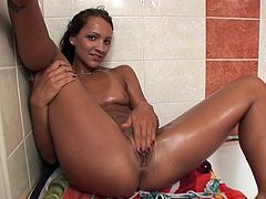 Beautiful girl feels like slamming her puffy twat while in the warm shower