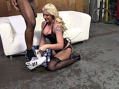 Pretty blondie in sexy lingerie gives a handjob and a blowjob to Black guy. Then Leya gets ass fucked in a cowgirl position in an interracial video.