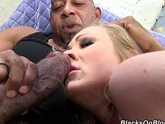 Big-assed blonde Vicky Vixen is doing all what she can to satisfy two black dudes. She sucks and licks their schlongs devotedly and then enjoys an ardent DP.