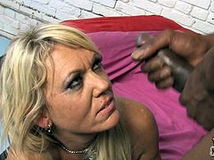 Powerful interracial sex scene with a hungry blond milf Chennin Blanc. She gives a nice head to her black male and then he drives her beaver.