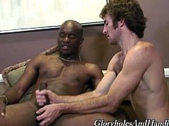 Glory Holes and Handjobs brings you a hell of a free interracial gay video where you can see how a horny white dude gets creamed by a hung black stud after some masturbation.