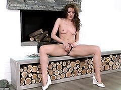 Brunette Sophie Moone is on the way to the height of pleasure with dildo in her vagina
