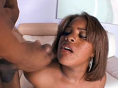 Chubby Black chick takes a negligee off. Then she drops to her knees to suck big black cock. After she lies down on a sofa and gets banged in her wet pussy.