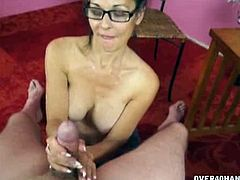 Trudy Lewis is Joey's sexy aunt. She decides to do something nice for her nephew, so she strokes his cock and licks his balls while showing him her big boobs.