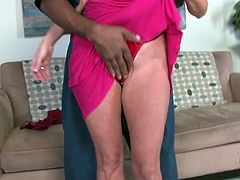 Press play to watch this blonde MILF, with giant tits wearing a cute dress, while she gets her shaved pussy smashed by a black guy.
