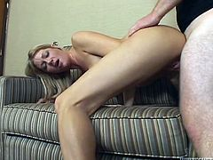 A gorgeous blonde slut sucks on a hard cock and then gets her fuckin' gash fucked hard in this motherfucker, check it out!