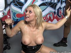 That's a damn interracial bukkake and Aiden Aspen is a damn victim. Though, she seems to be enjoying to handle so many black cocks at a time.