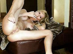 Brett Rossi with giant boobs and bald pussy taking toy in her wet spot