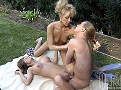 Chasey Lain and Debi Diamond are getting naughty with some dude in the garden. They favour the man with a blowjob and the one of the chicks gets her cunt and ass fucked hard.