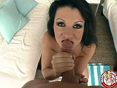 Insatiable black haired mommy Raquel Divine shows off her big knockers. Then nasty slut gets on her knees and blows cameraman's big shaved dick with pleasure.