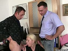 Mature secretary takes two young cocks in the office. She was here to make sure that she can still work but as soon as these boys fondle her body, she can't resist their hard dicks.
