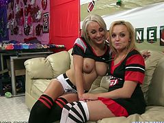 Take a look at this hot POV where these two horny blondes show off their big tits before taking turns sucking on this guy's big cock.