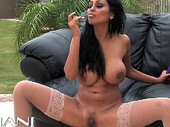 Check the busty brunette slut Priya Rai as she flaunts her exuberant body in a couch outside the house. Then she's ready to strip and dildo her pussy into heaven with a vibrator.