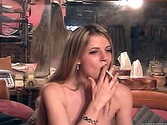 Anita Blue is a horny blonde fingering her wet pussy in this homemade video as you watch her having a cigarette as well.