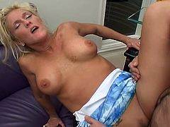 This mature blonde with big tits is home alone so she called her neighbor for dinner which converted to hard sex.