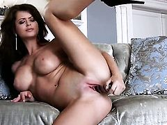 Emily Addison has fire in her eyes as she toys her slit
