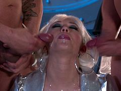 Kagney Linn Karter the sexy alien brings two stone age men to her spaceship. She sucks their huge dicks and then guys start to fuck Kagney like wild animals.