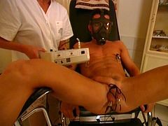 Medical mistress puts a mask on his face, spreads his legs and clothespins his balls and dick and tortures it hard