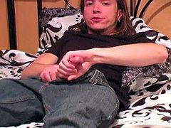 Checkout this long haired straight stud alone in his room and thinking to have some solo fun.See how he strips off his shirt and jeans, revealing his big cock, which he jerks on the bed.