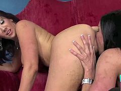 Jayden Jaymes assumes the doggy position for Kendra Lust to have access to her pussy. Kendra rubs it and munches on it. Next, Jayden massages Kendra's clit too.