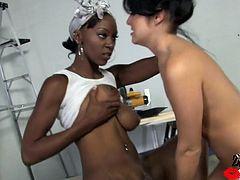 Entertain yourself by watching this ebony babe with titanic jugs while she forces this brunette to lick her pussy in a reality video.
