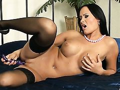 Claudia Capri with gigantic tits and clean pussy cant stop fingering her bush