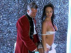 Alektra Blue stand on her knees and gives a blowjob to some man in a medieval costume. This MILF in lace lingerie spreads her legs and gets fucked in her shaved pussy.