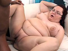 Check out this interracial video where a BBW mature lady sucks and is fucked by a big black cock in front of the camera.